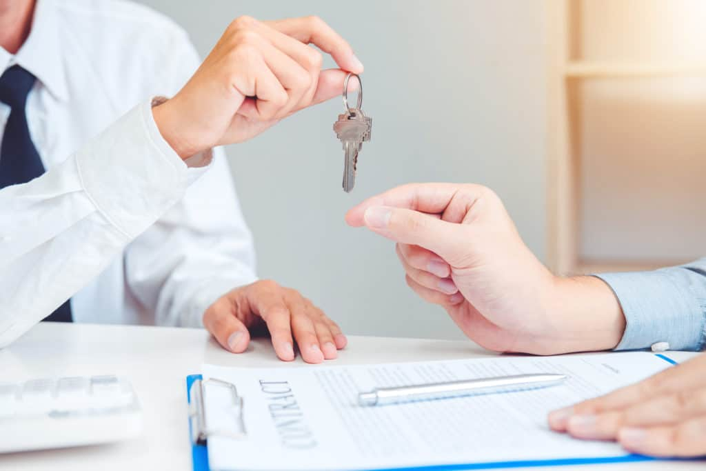 Sale agent giving Key house